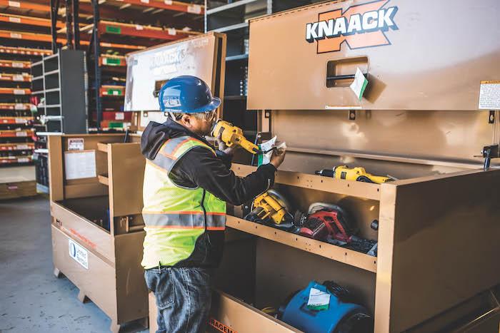 worker at tool box