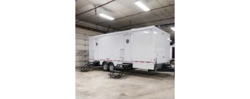 white restroom trailer