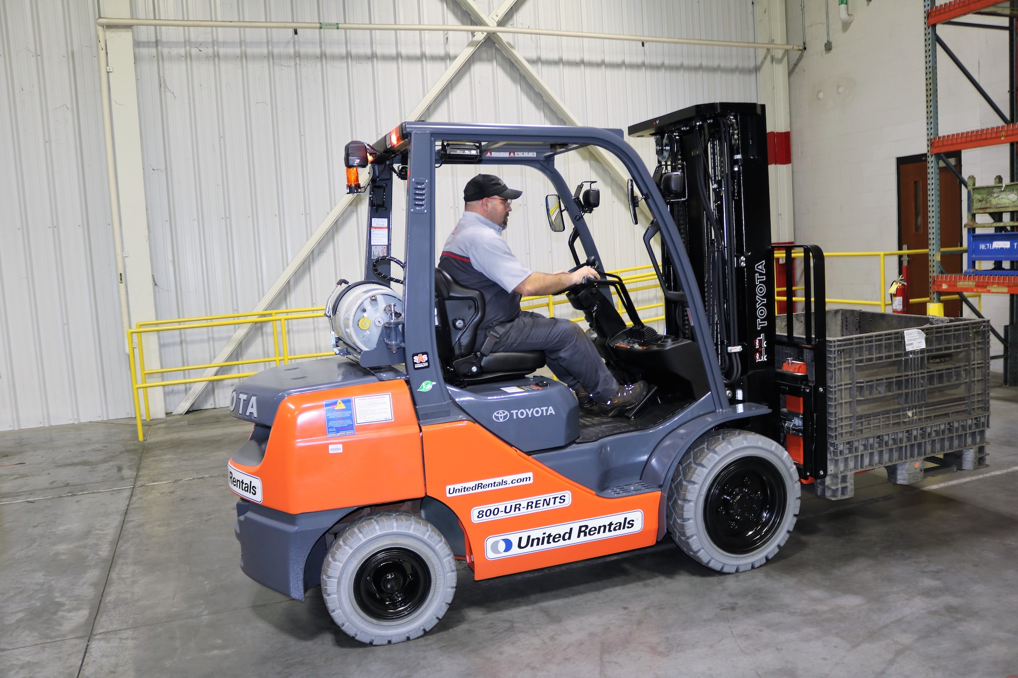 warehouse forklift orange in action
