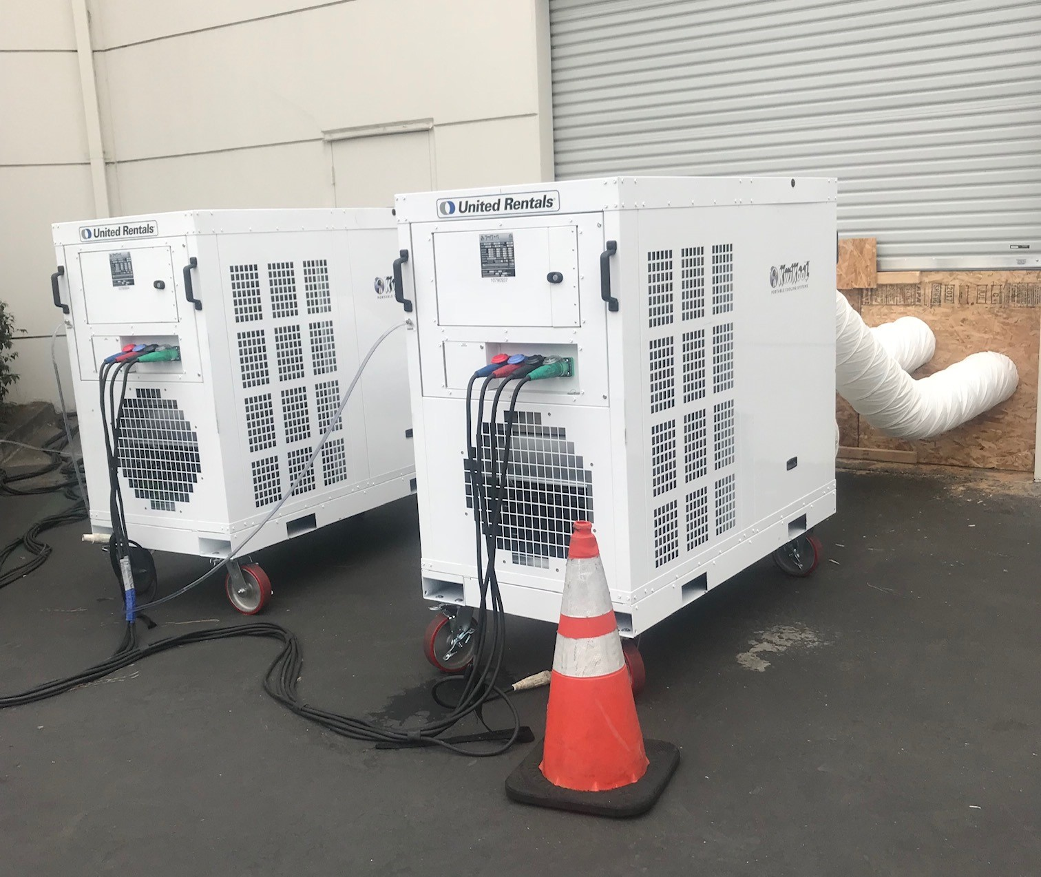 white temporary chiller systems outside a warehouse with ducting going in