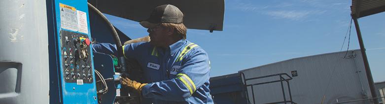 worker performing equipment maintenance