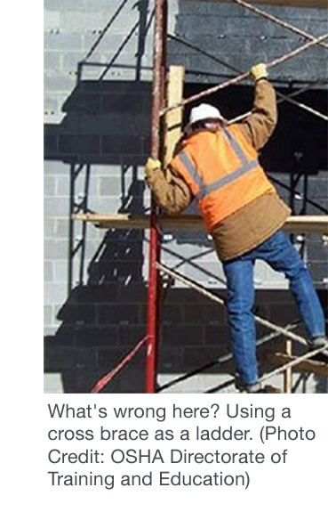 Worker unsafely using a cross brace as a ladder