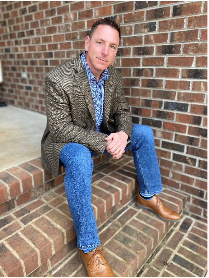reid stillwell sitting on brick stairs