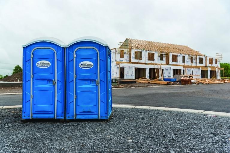 porta potties outside housing construction