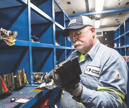 man organizing tools