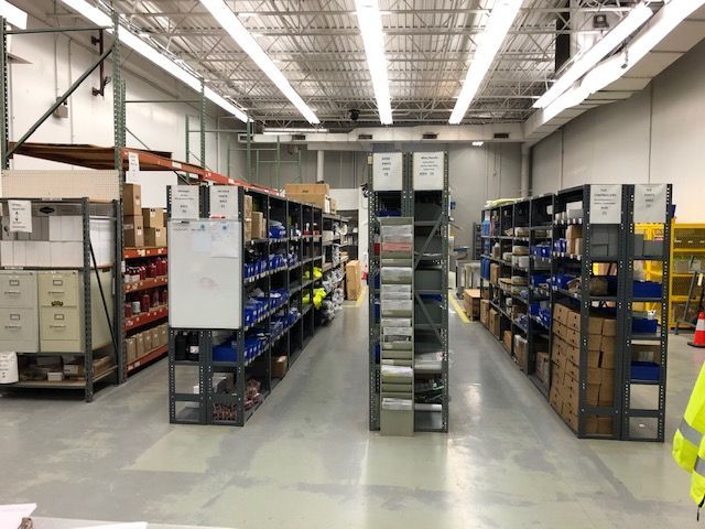 aisles of parts and supplies in a warehouse