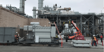 construction equipment and generators outside of power plant