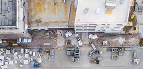 aerial view of worksite with cranes