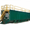 green mix tank with yellow safety rails