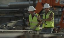 two men walking in ppe on construction site