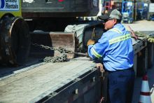 man loading truck with equipment