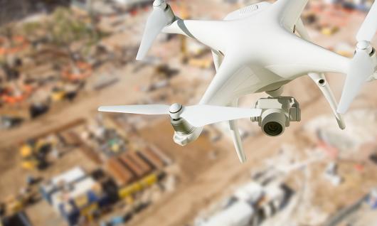 drone flying over jobsite