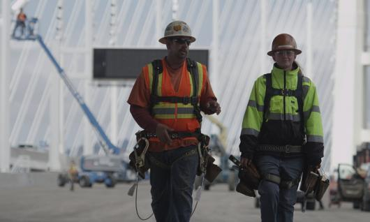 two men in hard hats on construction site