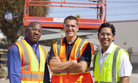 three men on jobsite in PPE