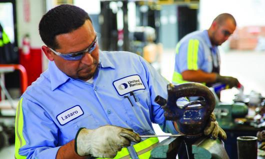 two men working in equipment shop