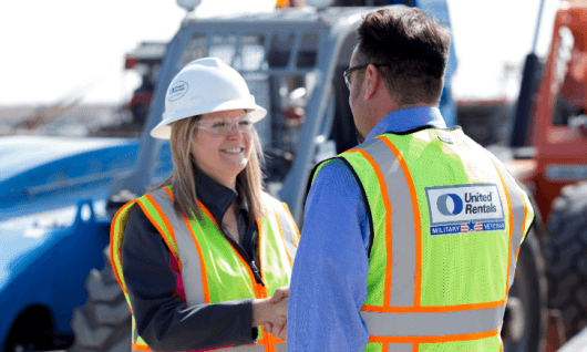 man and woman in ppe on jobsite