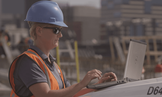 woman on jobsite with laptop