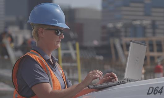 construction manager at computer