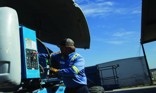 Mechanic Working on Equipment