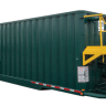 green frac tank with yellow stairs and safety rails