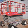 unextended scissor lift outside of building